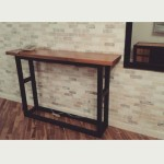 Black and brown console table.
