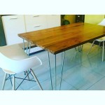 Steel and hardwood dining table and dining bench.