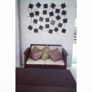 Square wood cuts on steel wall decor